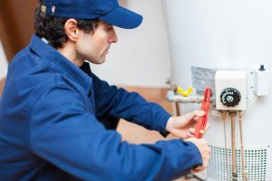 Picture of a plumber repairing a water heater