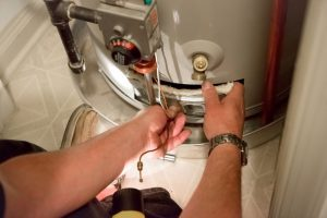 technician tightening valve