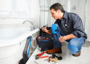 Picture of a professional plumber fixing bathtub