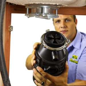 Plumber Fixing Garbage Disposal