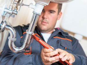 picture of a professional plumber doing repairs