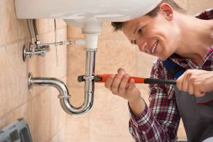 professional plumber photo changing sink pipe drainage