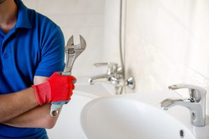 professional plumber photo with a wrench