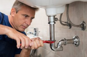 professional plumber working photo