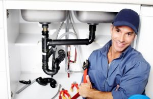 plumber posing in a camera after working photo