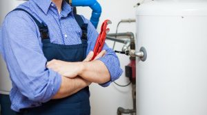 photo of a plumber poses after finishing job
