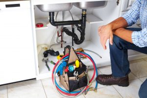 plumber after unclogging sink drain photo