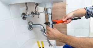 professional plumber fixing broken sink drainage picture
