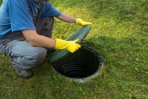 plumber cleaning septic tank photo
