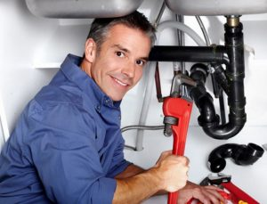 plumber with a wrench photo