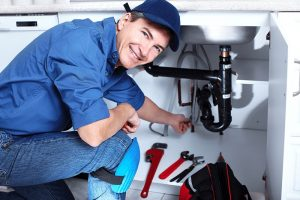 smiling photo of a plumber