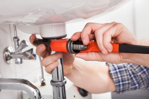 plumber photo while using a wrench