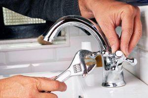 plumber fixing faucet handle photo