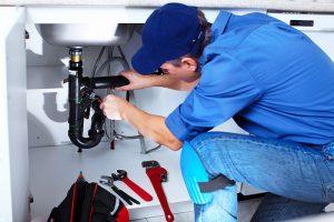 plumber fixing p trap photo