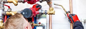 plumber fixing sprinkler photo
