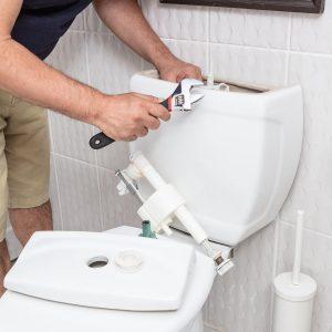 plumber fixing water closet photo