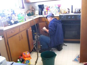 working plumber photo