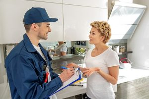 client and plumber talking photo