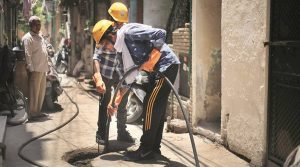 plumber at drainage system photo