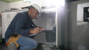 plumber checking at work photo