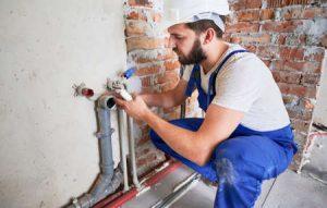 plumber repairing photo