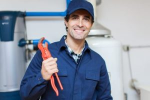 plumber with pipe wrench photo