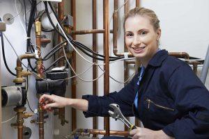 smiling woman plumber