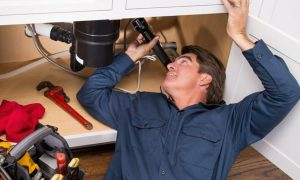plumber checking some leak problems photo