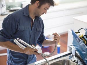 plumber replacing faucet photo